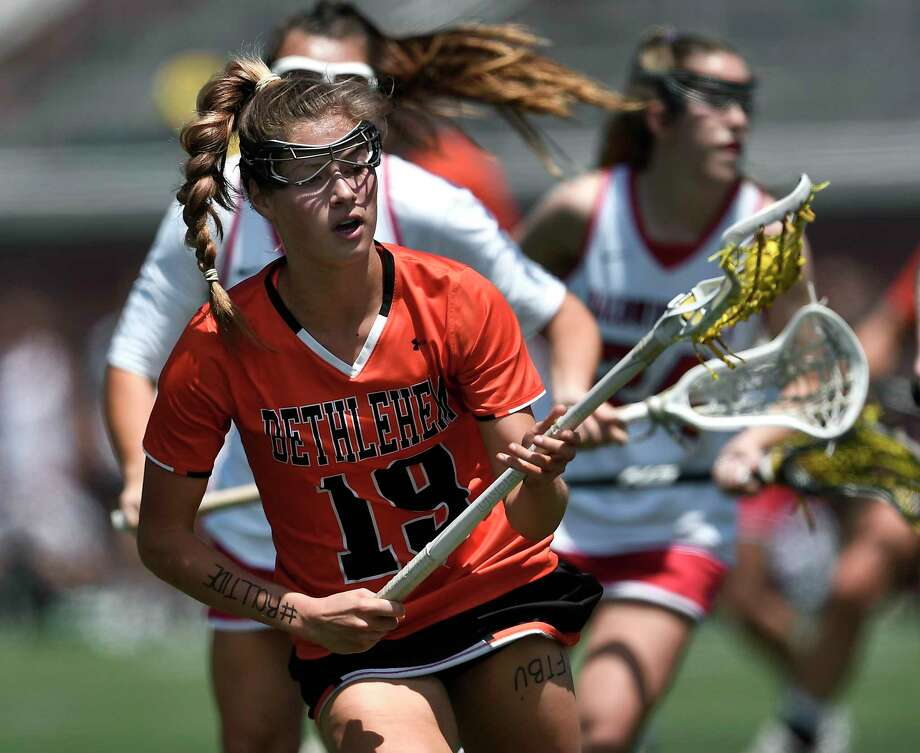 Bethlehem's Lindsay Ayres scoops up a loose ball during a Class A semifinal at the NYSPHSAA Girls Lacrosse Championships in Cortland, N.Y., Friday, June 7, 2019. Bethlehem's season ended with a 15-14 overtime loss to Baldwinsville-III. (Adrian Kraus / Special to the Times Union) Photo: Adrian Kraus / © akoPhoto 2019