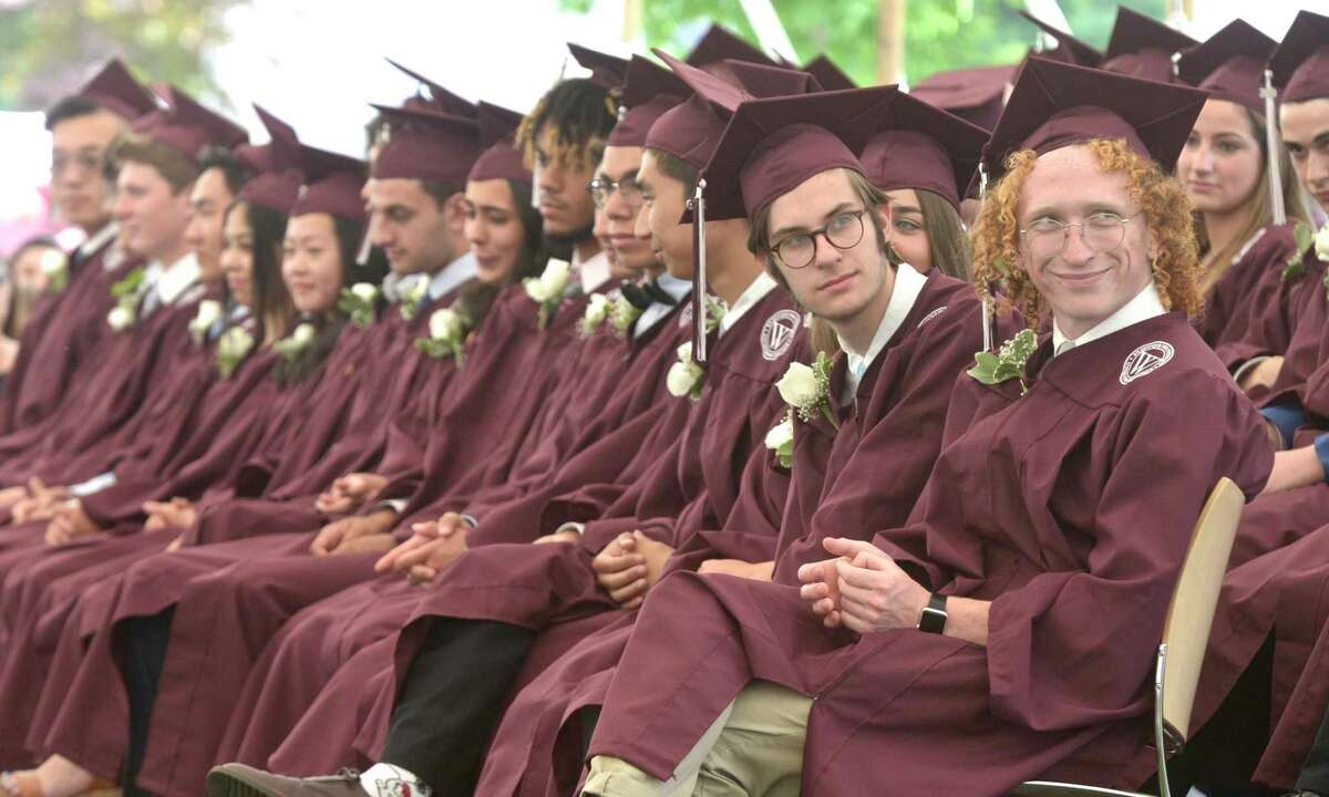 Ross Ian Spellman, right, smiles as he listens to a speech during the Class of 2019 Wooster School Commencement, Friday morning, June 7, 2019, Danbury, Conn.