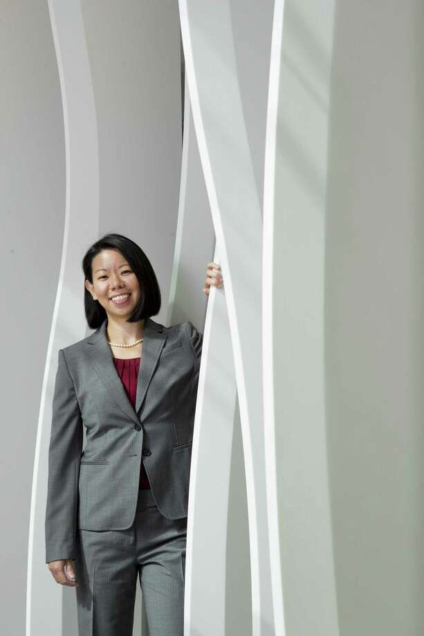 Lisa Wang, director, corporate and securities, Corporate Legal for TechnipFMC, played a critical role in the incredibly complex $13 billion merger of Houston-based FMC Technologies and Technip of Paris in 2017. Last year, she guided the newly formed company through a $460 million debt offering. Widely viewed as one of the brightest young stars in the Texas corporate legal world, Wang leads all governance, corporate compliance and regulatory matters for the company, which had $12.5 billion in revenues in 2018 and a market cap of $10 billion. Photo: Brett Coomer, Houston Chronicle / Staff Photographer / © 2019 Houston Chronicle