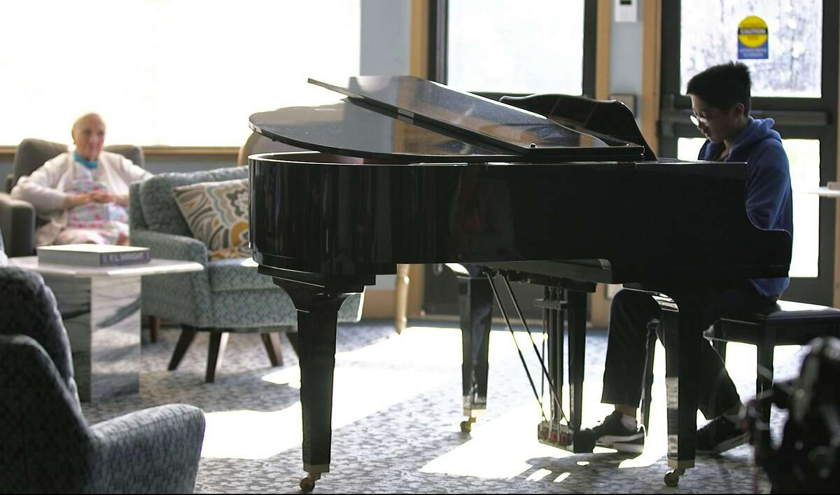 Christopher Nguyen, a 12-year old classical pianist, volunteers more than an hour every other week to play piano for groups of seniors at The Lodge, an Alameda-based senior care community. With over 120 classical music compositions memorized he plays directly from memory on May 31, 2019 at The Lodge in Alameda, California.