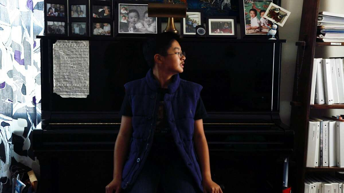 Christopher Nguyen, a 12-year old classical pianist, who has over a 120 classical pieces memorized and enjoys playing everything from FrŽdŽric Chopin ?'tude Op. 10, No. 3 to George Gershwin's Rhapsody in Blue, sits by his favorite piano which is in his home and looks out the window on June 1, 2019 in San Leandro, California.