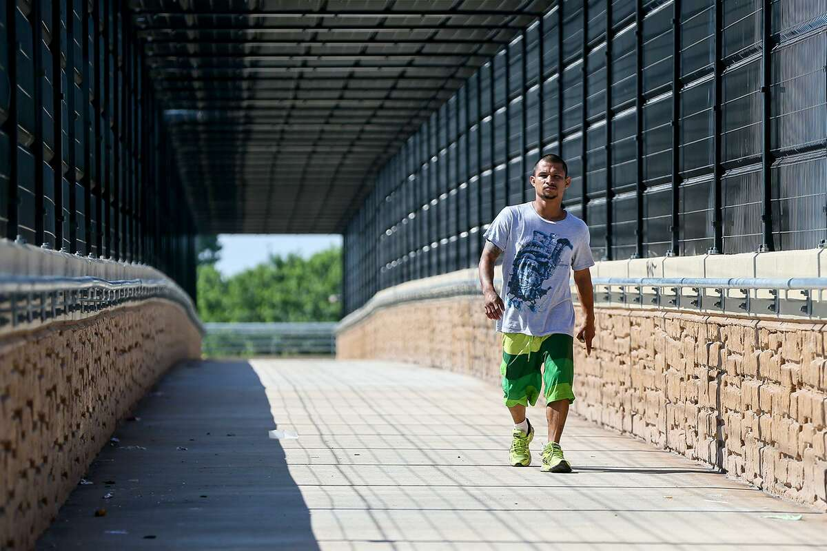Local resident Abel Vigil walks across the new pedestrian bridge over U.S. 90, between Loop 410 and Military Drive, on Friday, June 7, 2019. The bridge was built in response to pedestrian deaths that had occurred there from people running across the highway.