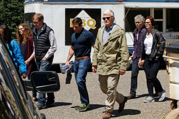 Federal Judge Williams Alsup,(green jacket) a PG&E group into the back entrance into Paradise Performing Arts Center for a closed door meeting, in Paradise, Ca., on Friday June 7, 2019.