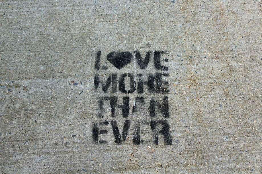 A phrase spraypainted onto a sidewalk in Westport. Photo: Melanie Espinal / For Hearst Connecticut Media