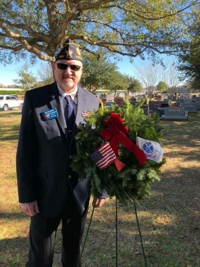 Jim McGuire is the new commander of Jonathan D. Rozier American Legion Post 164 in Katy. Above, he participated in the Wreathes Across America program in December to honor military veterans at Magnolia Cemetery in Katy. Photo: Courtesy Jim McGuire / Courtesy Jim McGuire
