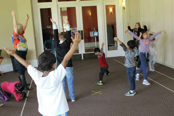 Ann Marie Morris, director/teacher, Drama Kids Katy, Houston & Fulshear, leads a spring break class in a routine called Bright Balloon. Students without saying a word move an imaginary balloon to music. Morris also is co-owner of the franchise.