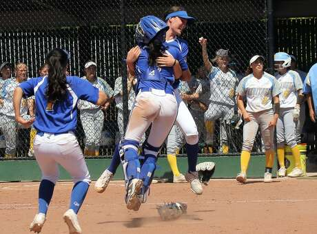 Foothill-Pleasasnton catcher Courtney Beaudin leaps and hugs pitcher Nicole May after the Falcons beat Heritage-Brentwood 2-0 for the North Coast Section Open Division title last month.