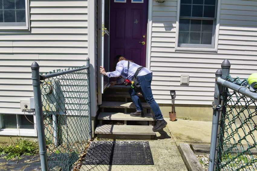 Home inspector Jolene Lomnes, owner of Informative Home Inspections, checks around the outside of a home on Wednesday, May 8, 2019, in the Town of Ballston, N.Y. (Paul Buckowski/Times Union)