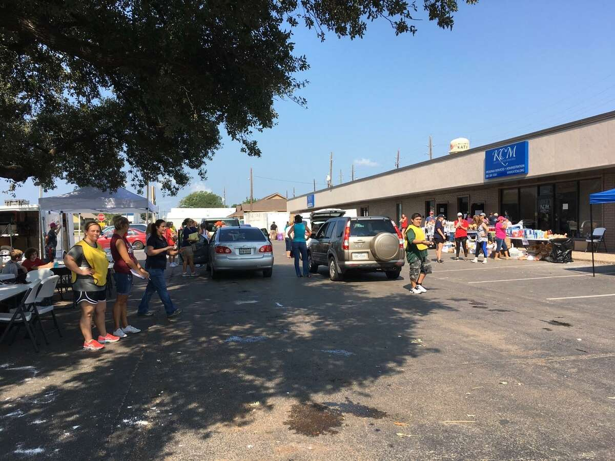 Damaged by flood waters, too, Katy Christian Ministries still helped flood victims. On Sept. 1, 2017, Deysi Crespo, KCM executive director, said the ministry had assisted 2,480 flood victims in two days. Above, volunteers on Sept. 2, 2017, again offered assistance.