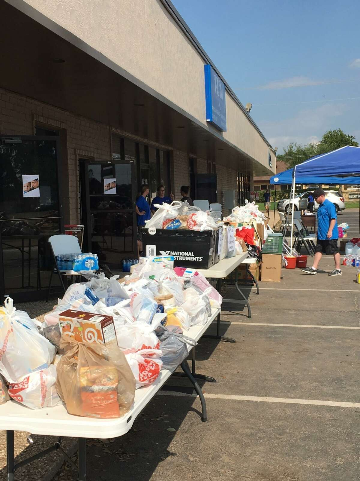 After Hurricane Harvey, Katy Christian Ministries set up tables to serve people. KCM began assisting those affected on Aug. 31, 2017, by providing them with non-perishable items such as food, water, cleaning supplies and personal care, said Holly Havlick, KCM food pantry director.