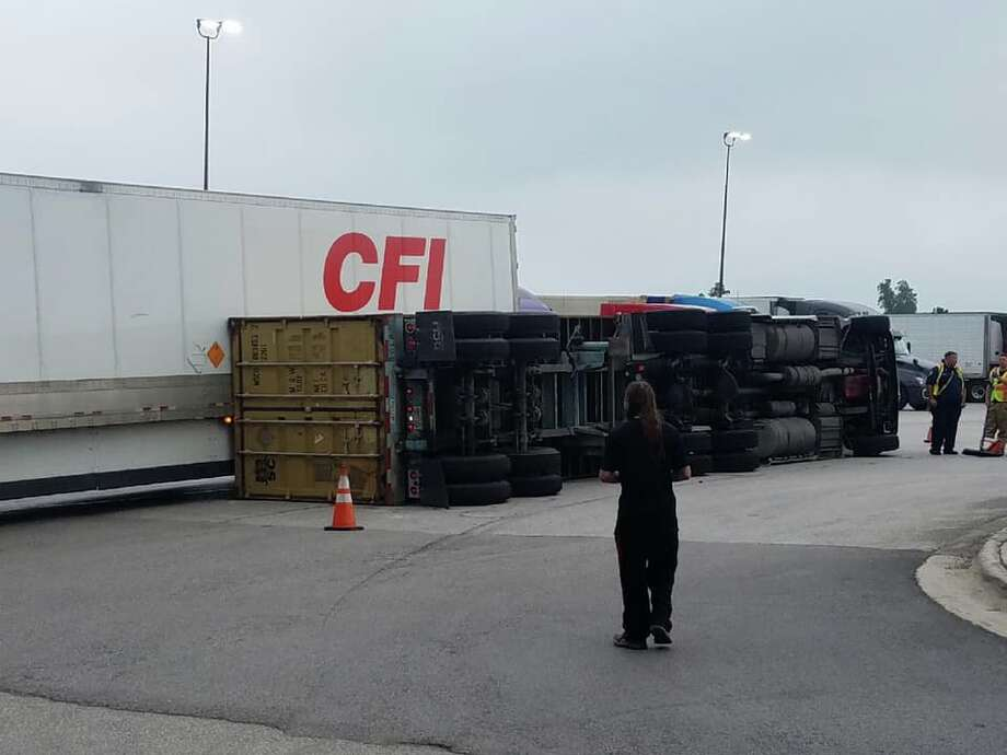 A tractor-trailer rolled over in Willis after its driver made a right turn and the cargo shifted to the side. Photo: Courtesy Of The Montgomery County Precinct 1 Constable's Office