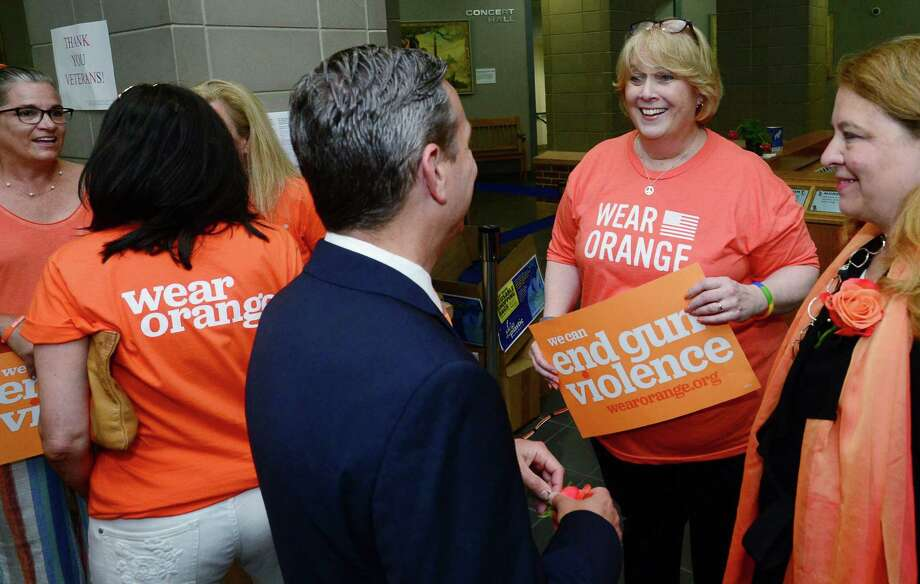 Members of Moms Demand Action, a nonprofit aimed at addressing gun violence, including Angela Whitford meet with State Senate Majority leader Bob Duff and State Representatives Lucy Datham aa wellas the Norwalk mayor Friday, June 7, 2019, as a part of a #WearOrange event to commemorate gun violence prevention week and honor the victims of gun violence at Norwalk City Hall in Norwalk, Conn. Photo: Erik Trautmann / Hearst Connecticut Media / Norwalk Hour