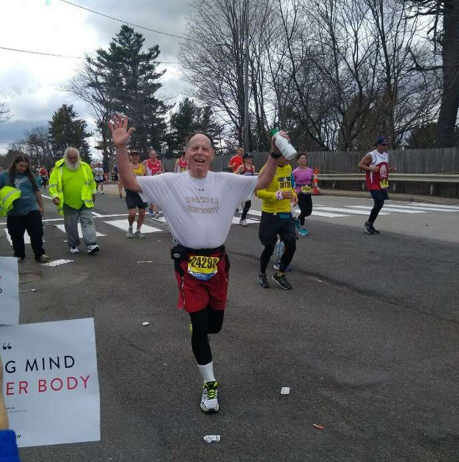 """Despite an earlier leg injury, Rick Tuttle of Kelliwood participated in this year's Boston Marathon. His regular running partner is Emmanuel Jackson, pastor at Living Word Lutheran Church. Their informal running group is called """"The Running Ministry."""" They run three days a week. Photo: Courtesy Kathy Tuttle / Courtesy Kathy Tuttle"""