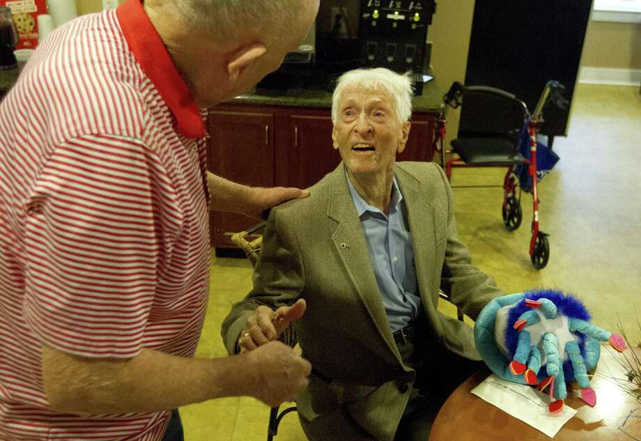 Morris Bateman visits with friends during a party in celebration of his 103rd birthday at Heritage Oaks, Wednesday, Dec. 12, 2018, in Conroe. A 70-year member of the Lions Club, Conroe Noon Lions members celebrated the life of Morris Bateman Sr. this week. He passed away on June 2 at age 103. Photo: Jason Fochtman, Houston Chronicle / Staff Photographer / © 2018 Houston Chronicle
