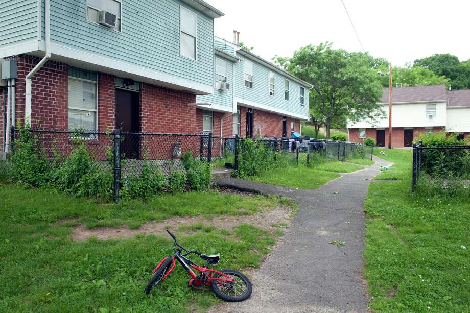 """Views of the Trumbull Gardens housing complex in Bridgeport in 2018. Mayor Joe Ganim and Police Chief Armando """"A.J."""" Perez say they are continuing efforts to increase the police department's presence within city communities like Trumbull Gardens. Photo: Ned Gerard / Hearst Connecticut Media / Connecticut Post"""