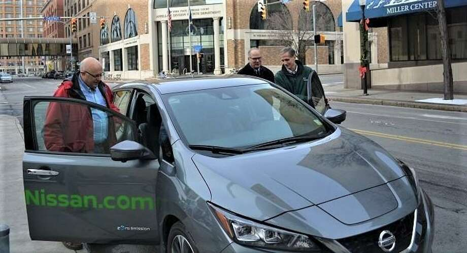 Employees of Rochester Gas & Electric, a subsidiary of Orange, Conn.-based Avangrid, test-drive a Nissan Leaf electric vehicle. Photo: Contributed Photo /