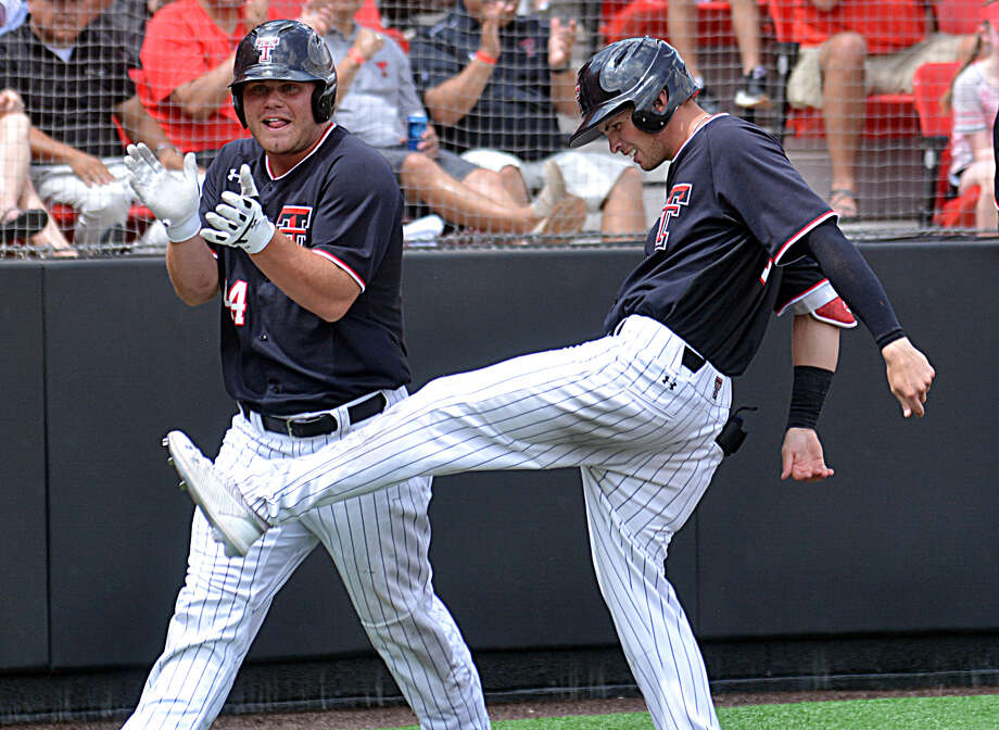 Texas Tech players Tanner O'Tremba (left) and Gabe Holt celebrate after scoring on a hit by Brian Klein to take a 5-0 lead over Army in the second inning of their Lubbock Regional baseball game on Friday at Rip Griffin Park in Lubbock. The host Red Raiders rolled to an 11-2 win to open up region play. Photo: Nathan Giese/Planview Herald