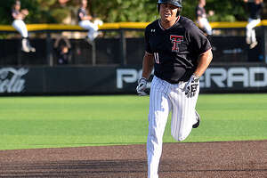 The Texas Tech bullpen celebrates as Cameron Warrern rounds the bases after his 3-run home run in the first inning against Dallas Baptist in the championship game of the Lubbock Region on Sunday on Dan Law Field at Rip Griffin Park.