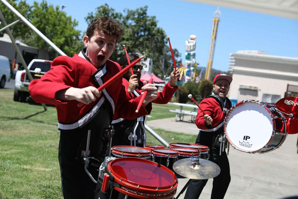Tyler Alcorn (l to r), Chris Canby and Adam Johnson, all with Boom Percussion Entertainment, perform during a media preview of the San Mateo County Fair at the San Mateo Events Center on Friday, June 7, 2019 in San Mateo, Calif. Boom Percussion Entertainment is new to the fair and will performing as a strolling act and strolling trashcan show.