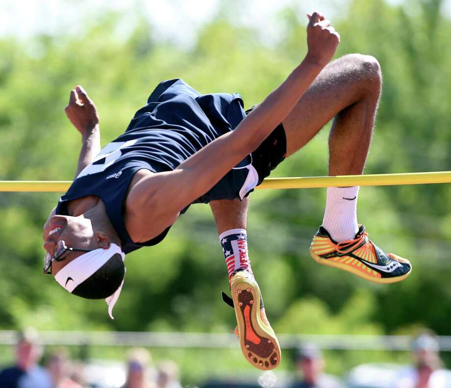 Staples' Chet Ellis set a state record in the high jump at the State Open on Monday. Photo: Arnold Gold / Hearst Connecticut Media / New Haven Register