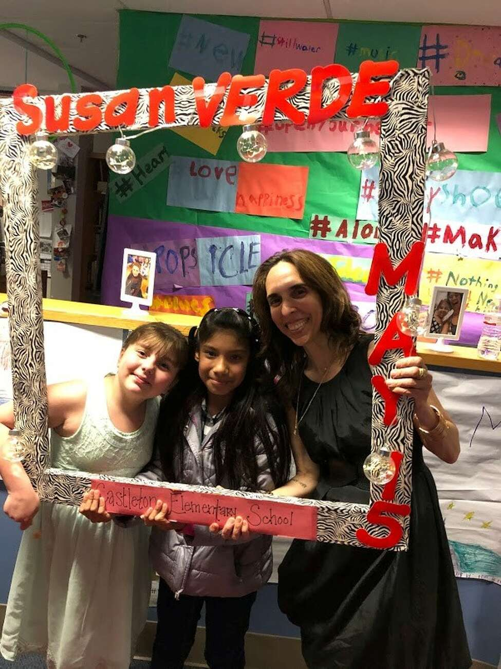 Ana Cruz-Cruz and Olivia Hoch, students at Castleton Elementary School, pose with children's author Susan Verde at the annual