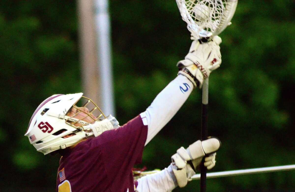 St. Joseph goalie Kyle Burbank (6) makes a save during Class S boys lacrosse semi-final action against Granby in Cheshire, Conn. on Wednesday June 6, 2018.