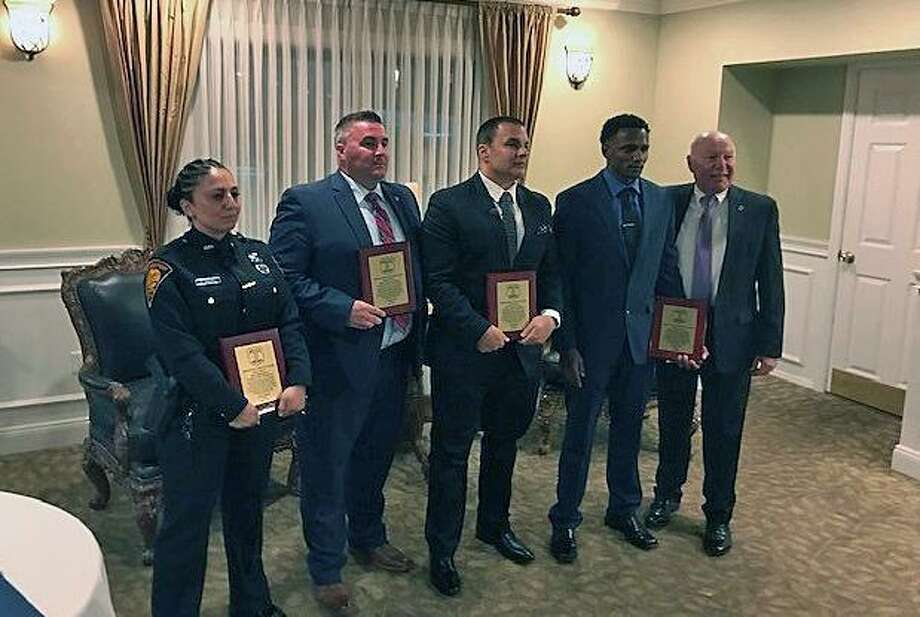 Mark Pappas, Arlindo Dos Santos, Diala Roberts and Thomas Flaherty -- all Bridgeport, Conn., police officers -- stand with Police Chief Armando Perez at a ceremony after the four officers each received a Meritorious Service Award. Photo: Contributed Photo / Bridgeport Police Department