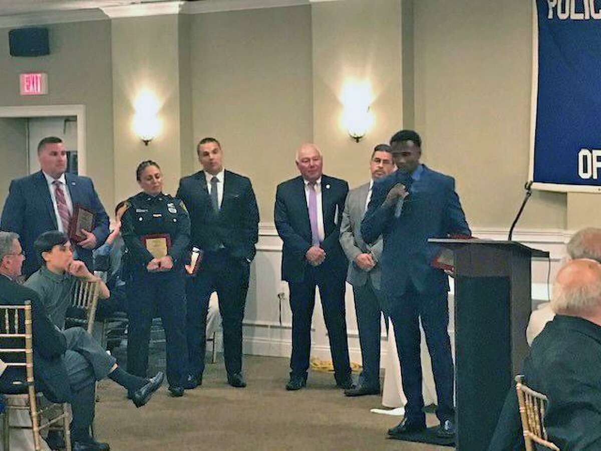 Mark Pappas, Arlindo Dos Santos, Diala Roberts and Thomas Flaherty -- all Bridgeport, Conn., police officers -- each received a Meritorious Service Award at a ceremony on May 28, 2019.