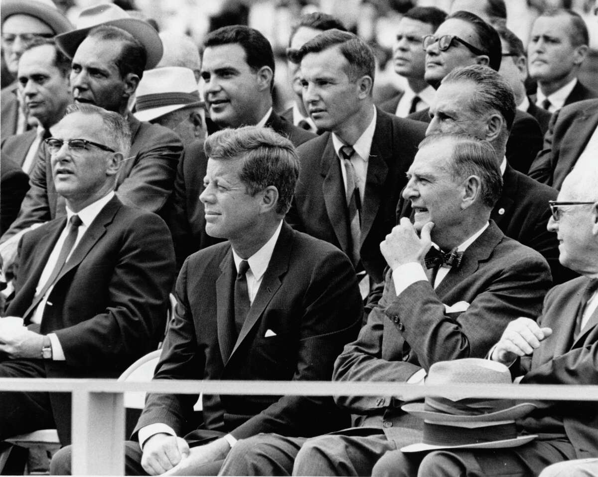 President John F. Kennedy sits next to U.S. Rep. Albert Thomas, right, during a visit to Rice University in 1962 where he delivered a famous speech about the moon race.