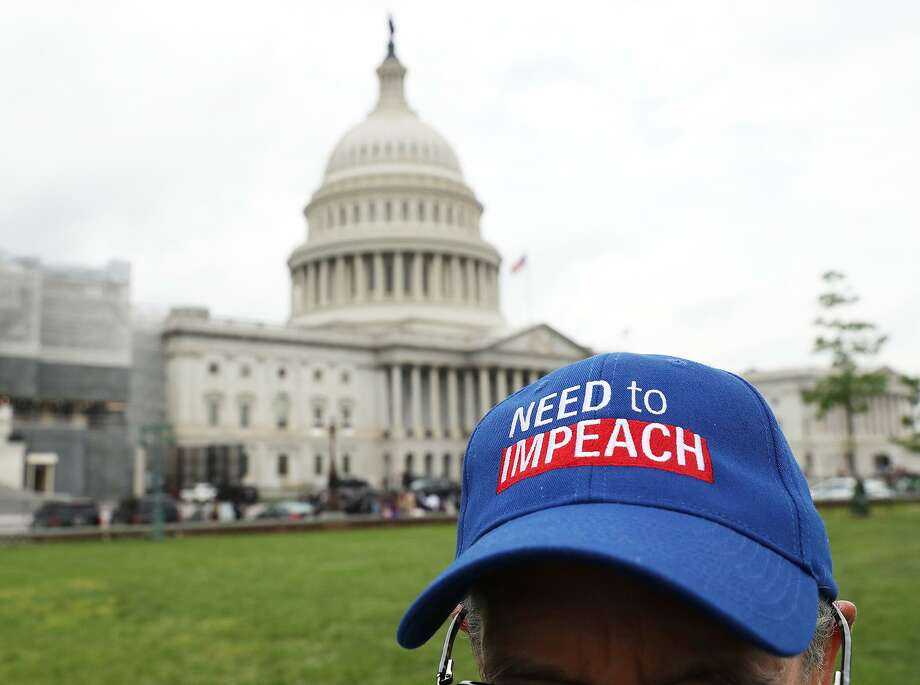 """Stephen Ross wears a """"Need To Impeach"""" hat during an event where activist groups plan to deliver more than 10 million petition signatures to Congress, urging the U.S. House of Representatives to start impeachment proceedings against President Donald Trump on Capitol Hill May 9. The Mueller report clearly draws a road map. Photo: Mark Wilson /TNS / Getty Images North America"""