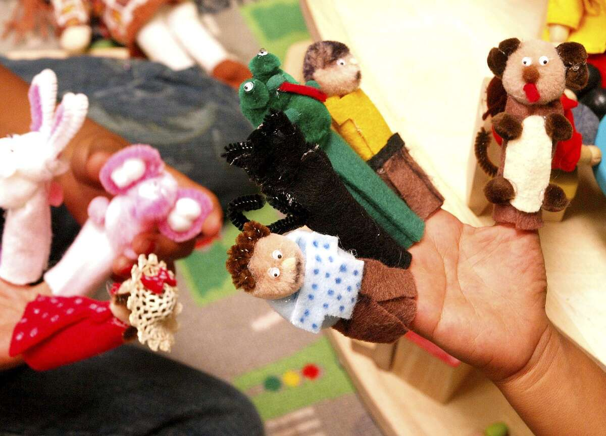 No family member is spared pain when family violence occurs. Here, children play with finger puppets in the new child therapy center of the Bexar County Family Justice Center in 2008.