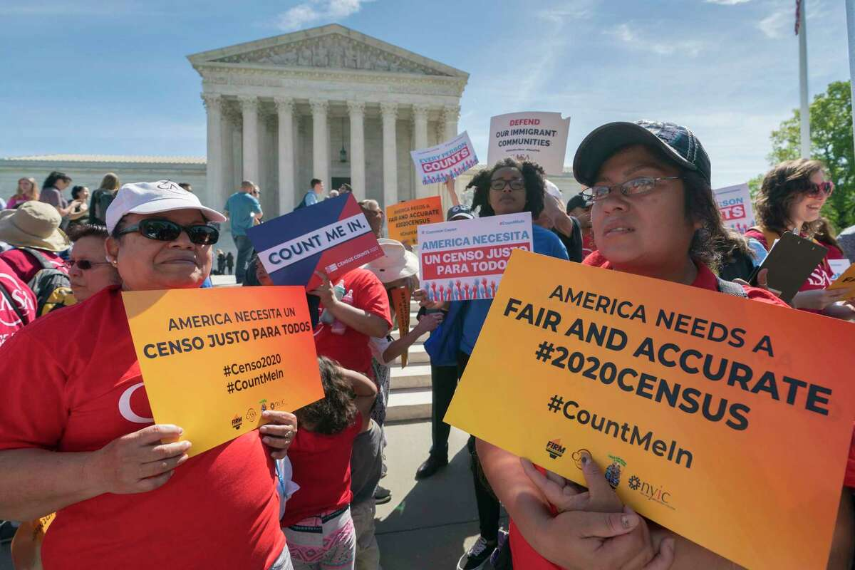 Activists rally in April outside the Supreme Court as the justices hear arguments over the plan to ask about citizenship on the 2020 census. Documents that surfaced after a GOP redistricting consultant died reveal the question was added to give Republicans an electoral advantage.