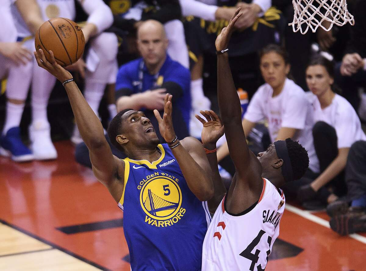 Golden State Warriors centre Kevon Looney (5) drives to the net against Toronto Raptors forward Pascal Siakam (43) during the first half of Game 1 of basketball's NBA Finals, Thursday, May 30, 2019, in Toronto. (Nathan Denette/The Canadian Press via AP)
