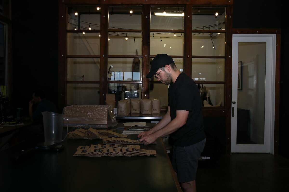 Ramon Gonzales, production assistant, preps retail bags at Red Bay Coffee, located at 3098 East 10th Street, in Oakland, Calif., on Friday, June 7, 2019. He is participating in CalSavers, the state-run retirement plan for employers that don't offer their own. Red Bay Coffee is a small but fast growing coffee roasting company. It had no retirement plan for employees until it enrolled this year in a pilot program for CalSavers.