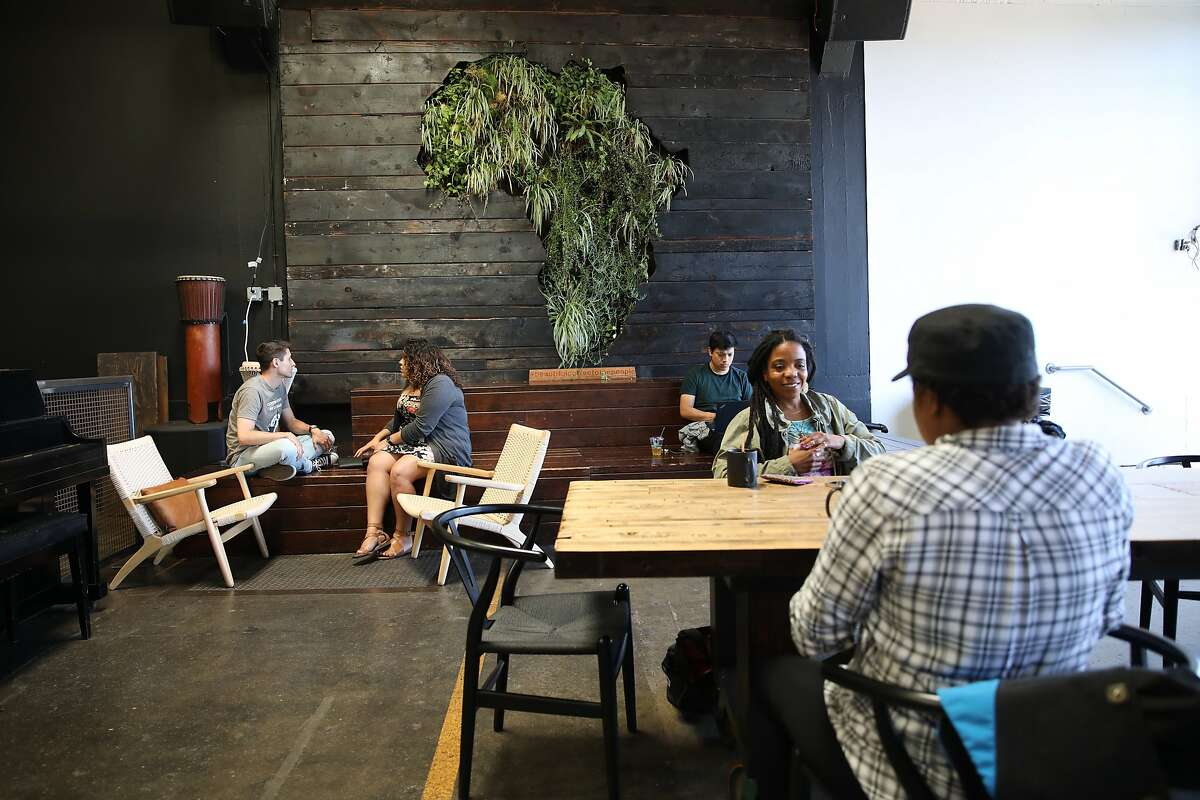 Customers relax at Red Bay Coffee, located at 3098 East 10th Street, in Oakland, Calif., on Friday, June 7, 2019. Red Bay Coffee is a small but fast growing coffee roasting company. It had no retirement plan for employees until it enrolled this year in a pilot program for CalSavers, the state-run retirement plan for employers that don't offer their own.