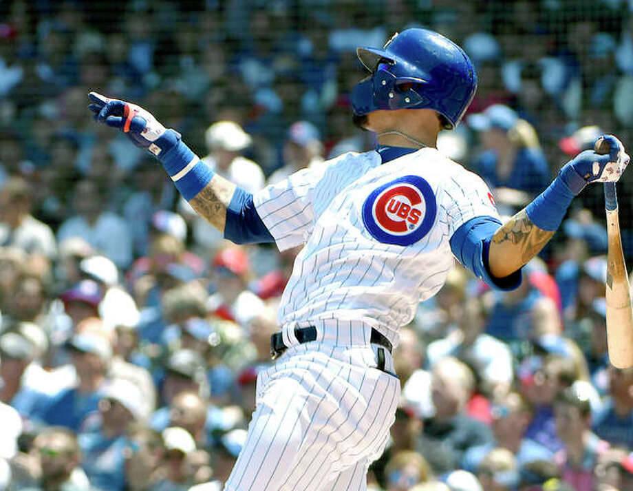 The Cubs' Javier Baez (9) hits a two run home run against the Cardinals in the first inning of Friday's game in Chicago. Photo: AP Photo