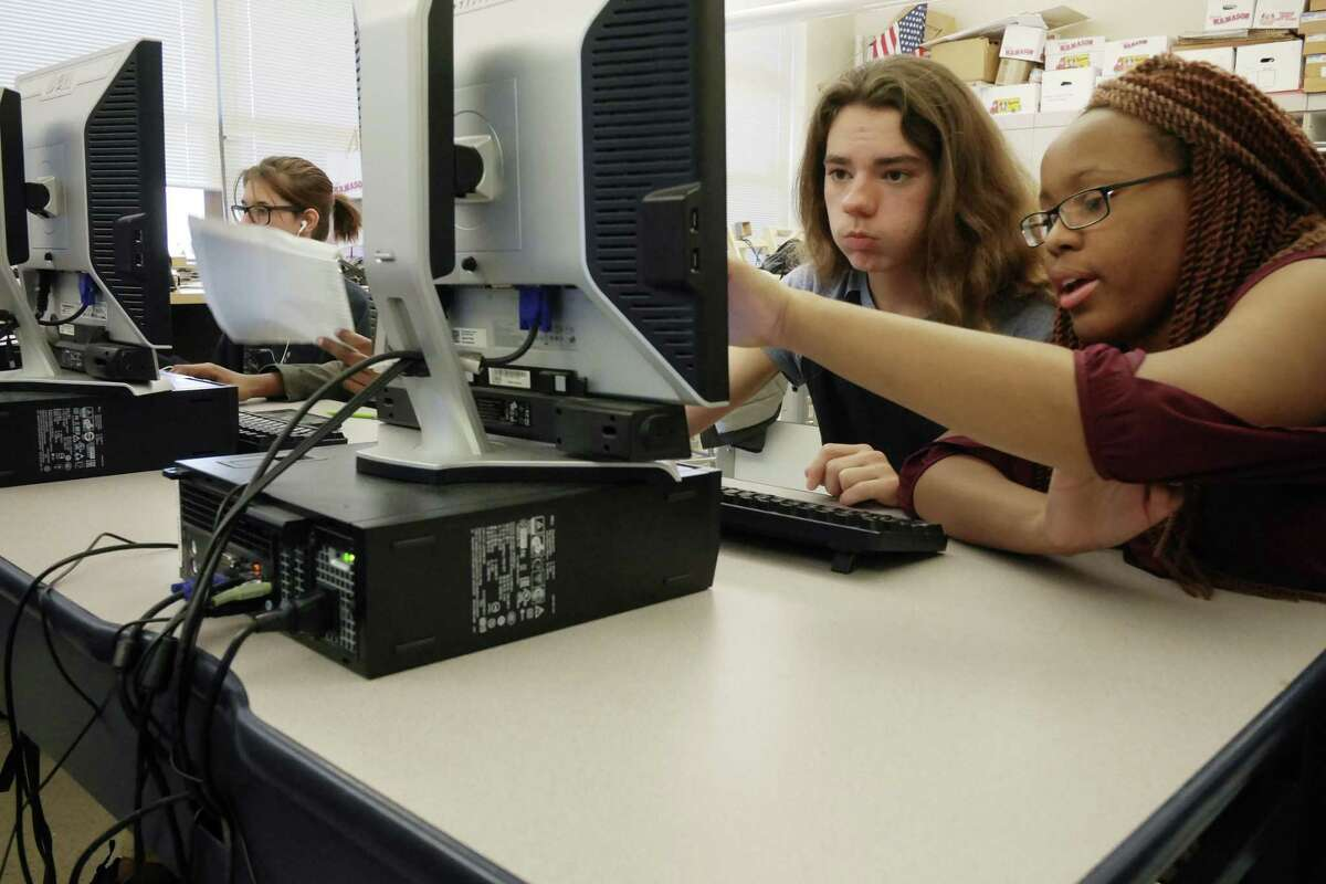 P-Tech program students, Hunter Demers, 15, left, and Quyana Thevenin, 16, work in their design and drawing class at Troy High School in Troy, N.Y. The national P-TECH model began in New York and spread two years ago to Texas, and SAISD now plans two of them, in cybersecurity and nursing. (Paul Buckowski / Times Union)