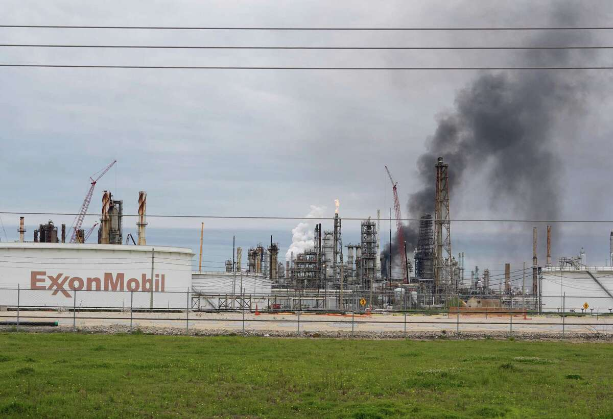 Smoke is shown rising from Exxon's Baytown facility, 5000 Bayway Drive, where a fire broke out Saturday, March 16, 2019.