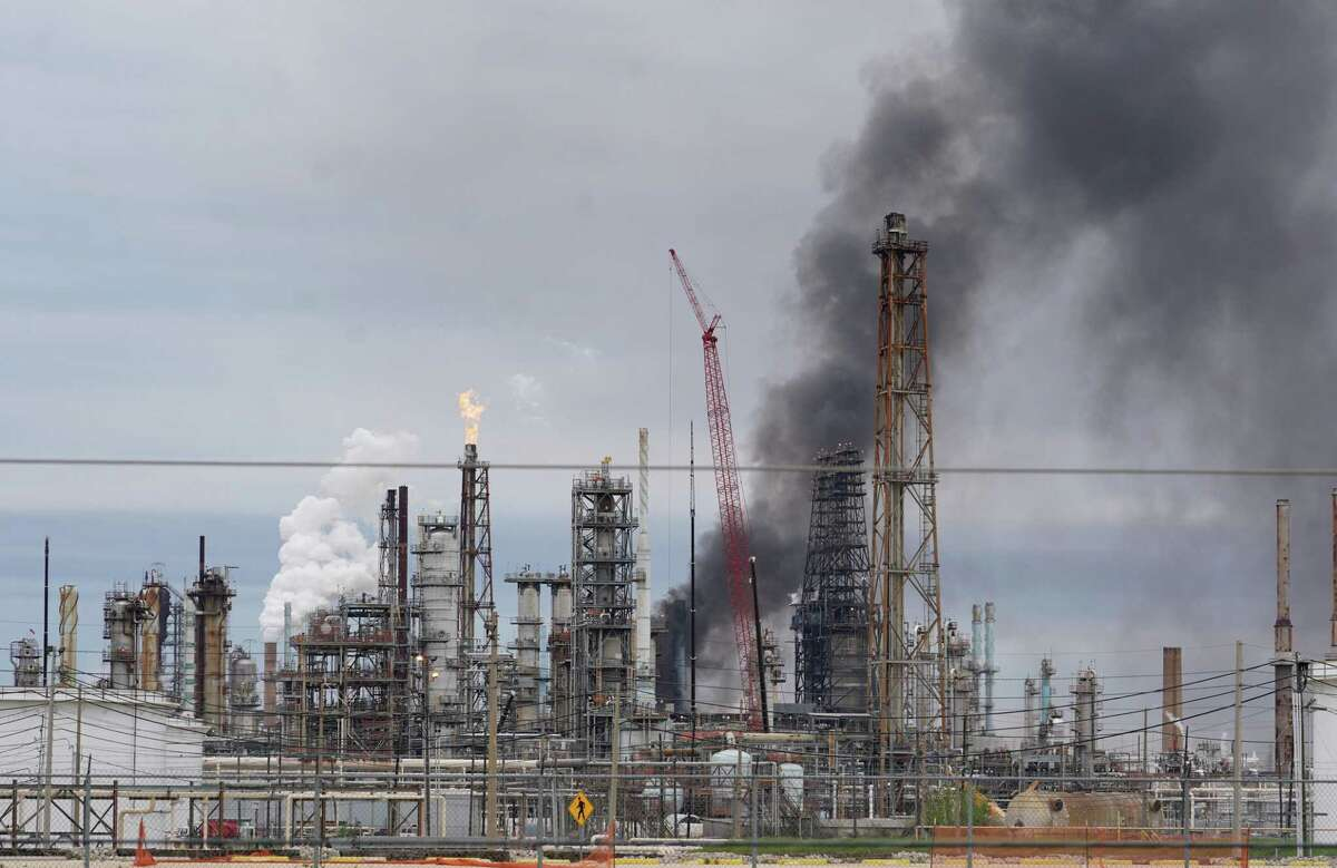 Smoke is shown at Exxon's Baytown facility, 5000 Bayway Drive, where a fire was reported Saturday, March 16, 2019. The company said air monitoring results show there was no off-site impact. Harris County filed a civil suit against the company on May 1 for violating the Texas Clean Air Act, the Texas water code, and health and safety code.