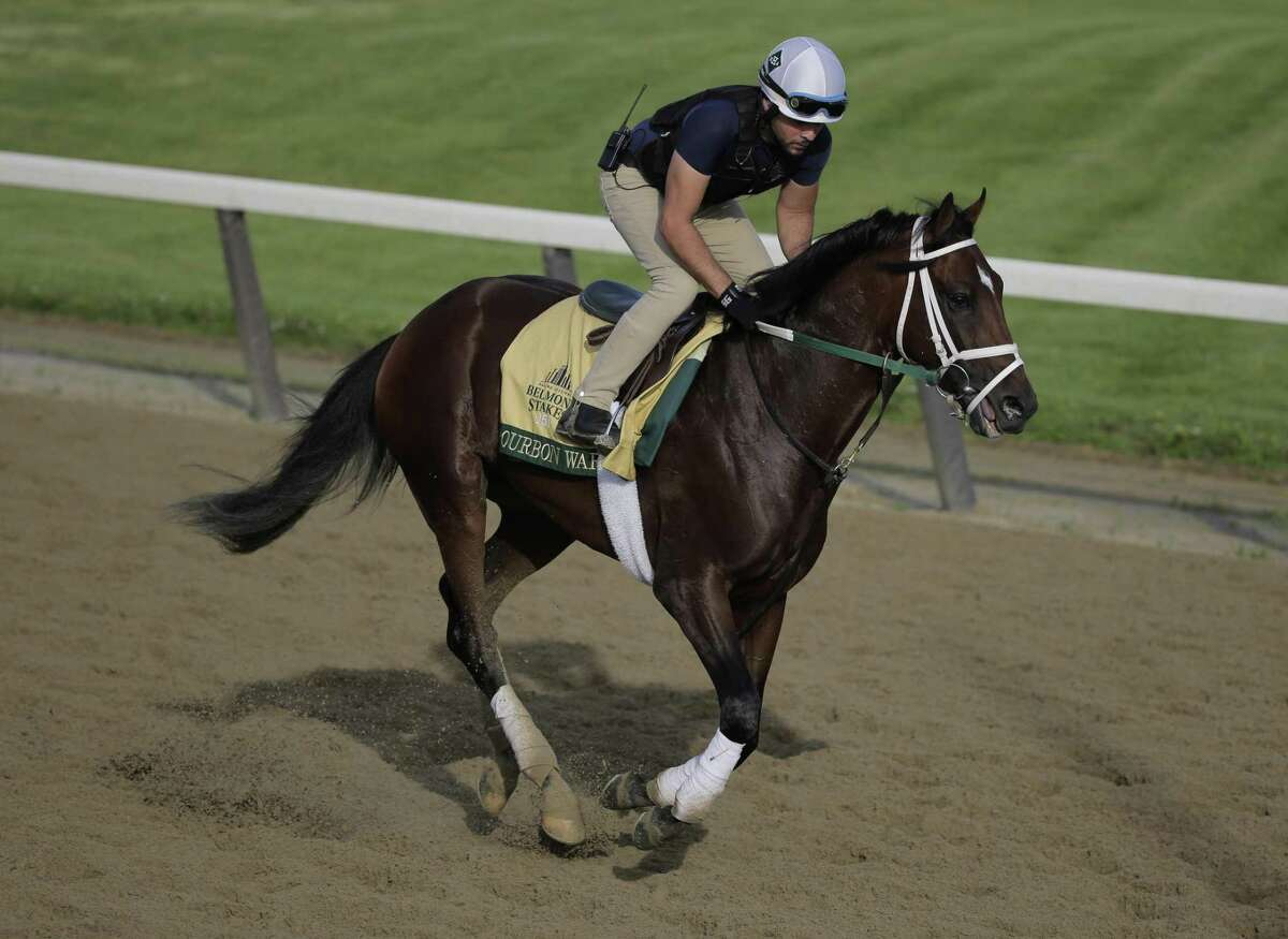 Exercise rider Jose Mejia rides Bourbon War during a workout at Belmont Park in Elmont, N.Y. on Friday.
