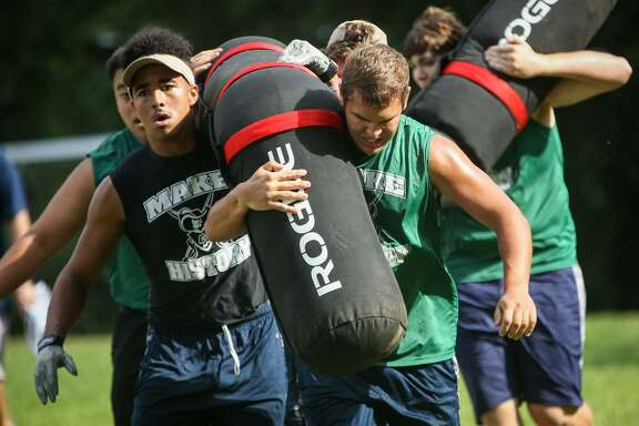 College Park linemen participate in the Worm Carry event during the Oak Ridge War Zone Lineman Challenge on Saturday, June 18, 2016, at Oak Ridge High School. (Michael Minasi / Chronicle)