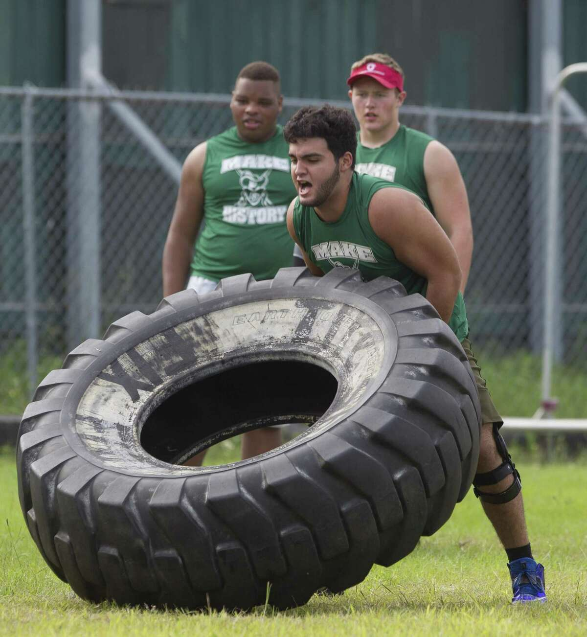 College Park's Mark Thompson competes in the annual War Zone Lineman Challenge at Oak Ridge High School on June 17, 2017.