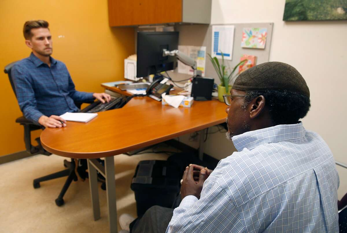 Robert Reed (right) meets with Dr. Jeffrey Seal, a physician and the medical director of the Alameda County Health Care for the Homeless clinic, in Oakland, Calif. on Thursday, June 6, 2019. A dozen mayors have sent a letter to the Board of Supervisors urging the release of more funds to handle the county's growing homeless population.