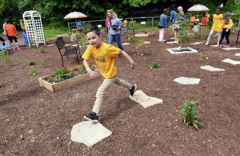 Kindergartner Eli Portorello, 6, walks along stepping stones at the new schoolyard habitat and outdoor classroom at Momauguin Elementary School in East Haven on June 5, 2019. Photo: Arnold Gold / Hearst Connecticut Media / New Haven Register