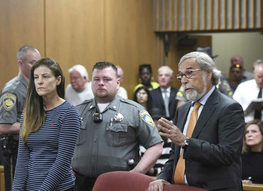 Attorney Andrew Bowman, right, speaks during the arraignment of his client Michelle C. Troconis, left, on charges of tampering with or fabricating physical evidence and first-degree hindering prosecution at Norwalk Superior Court in Norwalk, Conn. Monday, June 3, 2019. Troconis and Fotis Dulos were arrested at an Avon hotel late Saturday night and held on a $500,000 bond for charges of tampering with or fabricating physical evidence and first-degree hindering prosecution. Fotis Dulos is the estranged husband of Jennifer Dulos, the 50-year-old mother of five who has been missing since May 24. Photo: Tyler Sizemore / Hearst Connecticut Media / Greenwich Time