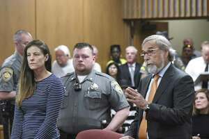 Attorney Andrew Bowman, right, speaks during the arraignment of his client Michelle C. Troconis, left, on charges of tampering with or fabricating physical evidence and first-degree hindering prosecution at Norwalk Superior Court in Norwalk, Conn. Monday, June 3, 2019. Troconis and Fotis Dulos were arrested at an Avon hotel late Saturday night and held on a $500,000 bond for charges of tampering with or fabricating physical evidence and first-degree hindering prosecution. Fotis Dulos is the estranged husband of Jennifer Dulos, the 50-year-old mother of five who has been missing since May 24.