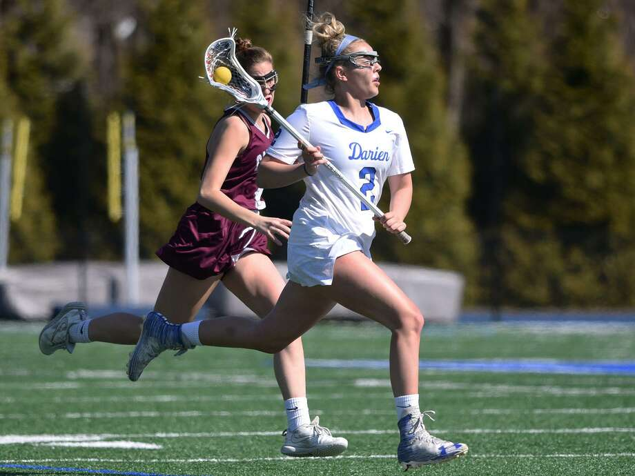 Darien's Ashley Humphrey beats an opponent through the midfield against Garden City on April 6. Photo: Dave Stewart / Hearst Connecticut Media / Hearst Connecticut Media