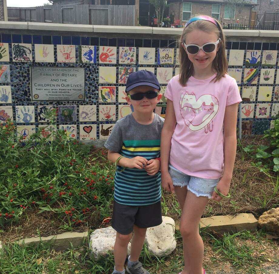 Chase and Evie Mason, son of Beaumont Rotarian Chad Mason and wife Lauren, and grandson of Past District Governor Chuck Mason and Governor Elect Becky Mason, visited Memory Park for the first time over the Memorial Day weekend. The children are standing in front of the Children's Wall donated by Chuck and Becky. Photo: Courtesy Photo