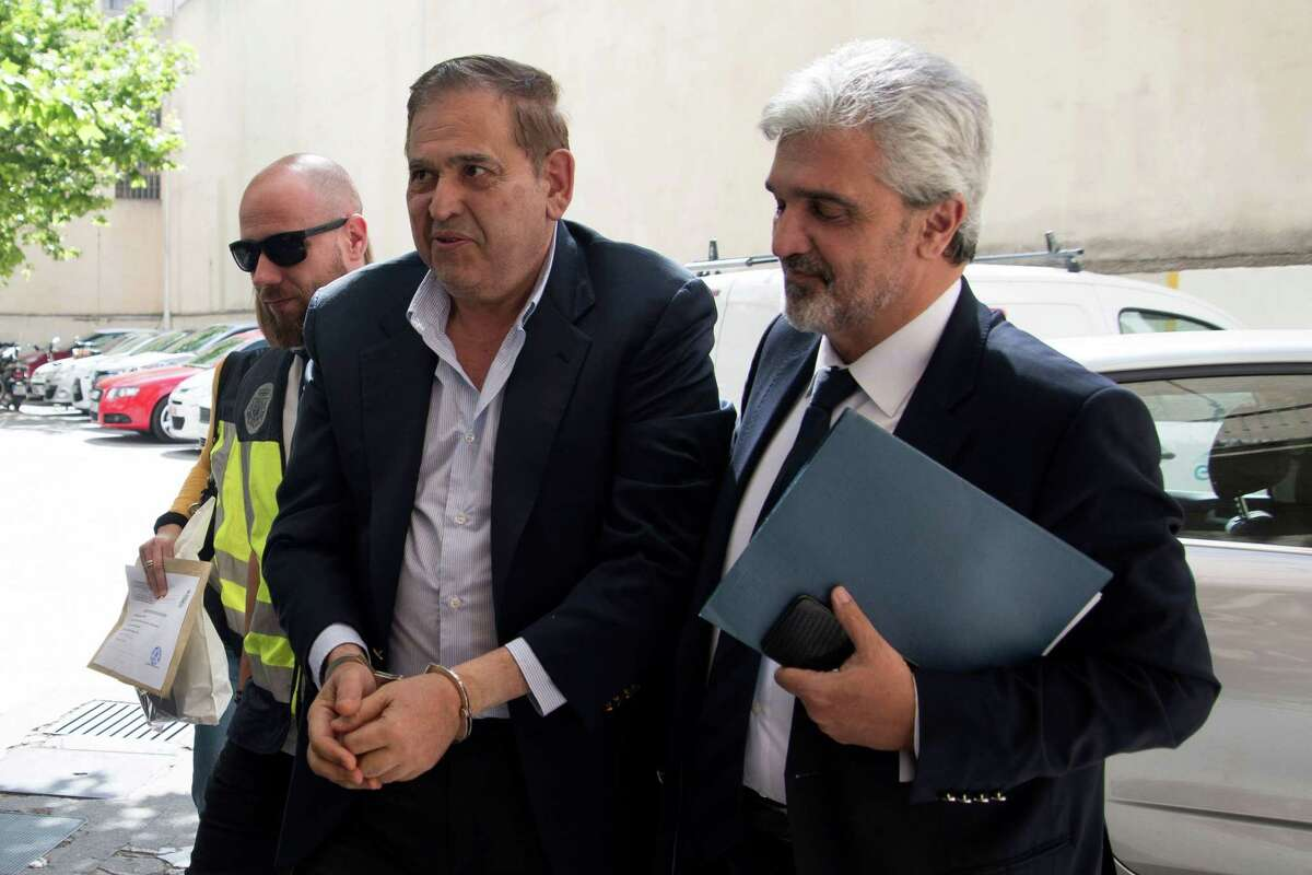 Alonso Ancira (C), head of Altos Hornos de Mexico, arrives to court in Palma de Mallorca on May 29, 2019 after being arrested on the Spanish island. - The Mexican executive accused of orchestrating the sale of a defunct business to state oil company Pemex for nearly half a billion dollars was arrested on May 28 on the Spanish island of Mallorca, his firm said. (Photo by STR / AFP)STR/AFP/Getty Images