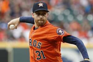 Houston Astros starting pitcher Collin McHugh (31) pitches during the first inning of an MLB baseball game at Minute Maid Park, in Houston, Friday, April 26, 2019.